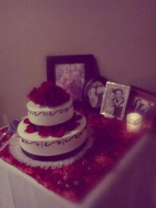 This was our wedding cake with all of the old photos of both sets of our grand parents who wanted to remember on our wedding day.
