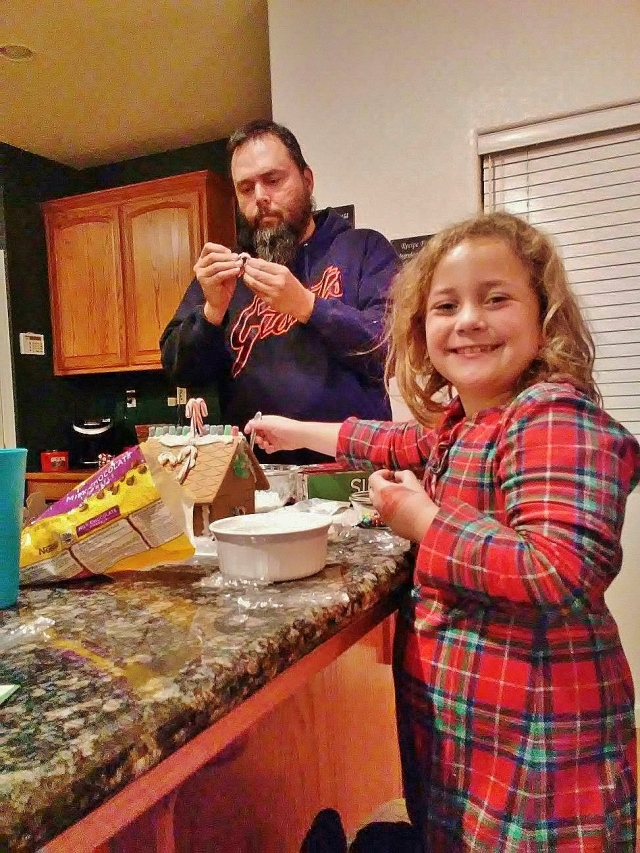 claire-and-chris-making-gingerbread-house-2